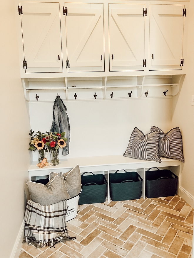 Mudroom Mudroom with dark hardware against the off-white cabinet and the herringbone brick flooring #Mudroom #Mudroomcabinet Mudroomflooring #herringbone #brickflooring #herringbonebrick #herringbonebrickflooring