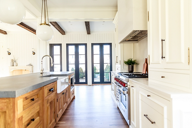Kitchen Cabinet Trend Painted perimeter cabinet with natural wood lightly stained kitchen island New Kitchen Cabinet Trends #Kitchen Cabinet Trends #KitchenCabinetTrend #KitchenCabinetTrends #Kitchentrends #CabinetTrend
