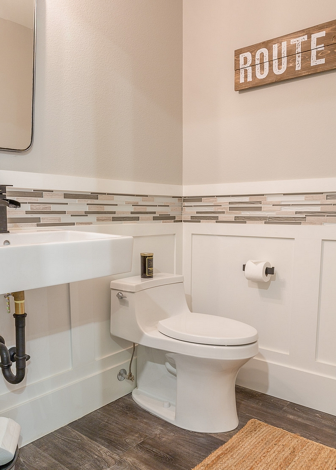 Powder room Paint color is Repose Grey SW 7015 by Sherwin Williams. Wainscoting is Super White by Benjamin Moore. Notice that a mosaic tile was placed just above the wainscoting #powderroom #wainscoting