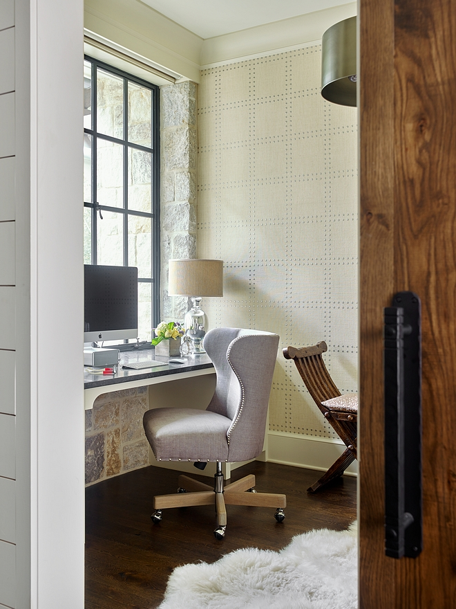 Home Office Small Home Office This small but elegant home office features a custom Oak barn door with rustic hardware, a Weathered Granite stone walls, black steel windows and a custom desk with side cabinets #office #homeoffice #smallhomeoffice #desk #wallpaper #customdesk