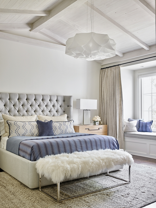 Bedroom Vaulted beamed ceiling The master bedroom features a stunning greywashed vaulted ceilings with shiplap and exposed beams and an inviting window-seat Bedroom Vaulted beamed ceiling #bedroom #Bedroomceiling #Vaultedbeamedceiling #shiplap #greywashbeam #beamedceiling #windowseat