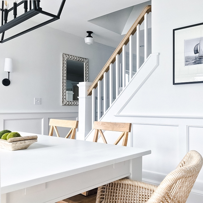 White interiors with black matte lighting and black and white photography Beautiful contrast against the white walls painted in Benjamin Moore Super White Black and white #BenjaminMooreSuperWhite #whiteinteriors #blackmatte #blackmattelighting #blackandwhite #blackandwhitephotography