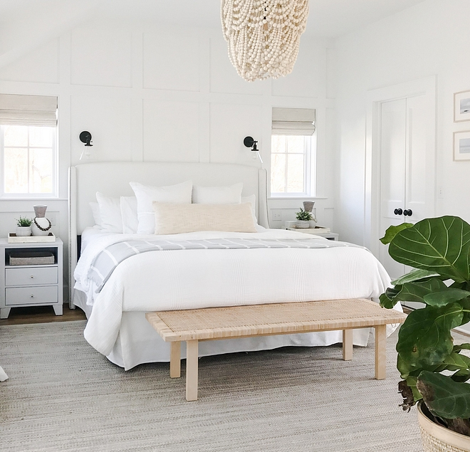 Coastal Bedroom White Bedroom Featuring white grid board and batten accent wall, vaulted ceilings, white furniture and natural elements, the master bedroom balances coastal design with an elegant approach Coastal Bedroom White Bedroom Featuring white grid board and batten #CoastalBedroom #WhiteBedroom #gridboardandbatten