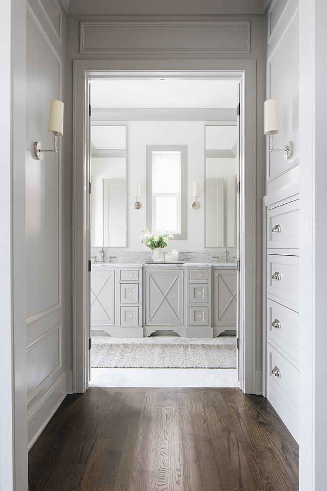 Master Bathroom Hallway with built-in dresser opens to a stunning grey master bahroom with x inset doors #bathroom #MasterBathroom #Hallway #builtidresser #greybatrhoom #bahroom #xinsetcabinetdoors