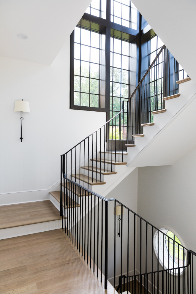 Metal railing spindles staircase The stunning staircase features custom iron railings, hardwood threads and black steel windows #ironrailings #ironstaircase #metalstaircase #blacksteelwindows #Metalrailing #metalspindles #staircase