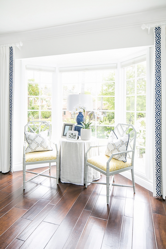 Bay windows It's always trick to design a room with bay windows The designer smartly added a charming sitting area to this space Living room bay windows #baywindows #baywindowideas #livingroom