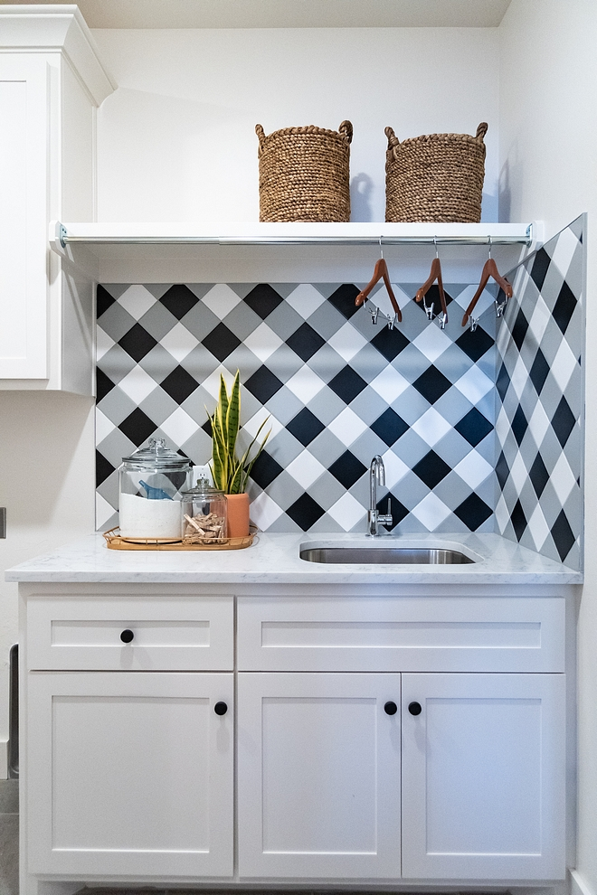Plaid Tile Plaid Backsplash The laundry features 4x4 tiles (in white, grey and black tiles) in a buffalo check pattern. This is a fun and affordable way to add character to any space - it could even work on floors, just use larger tiles #plaidtile #PlaidBacksplash #buffalocheck #tile #tilepattern
