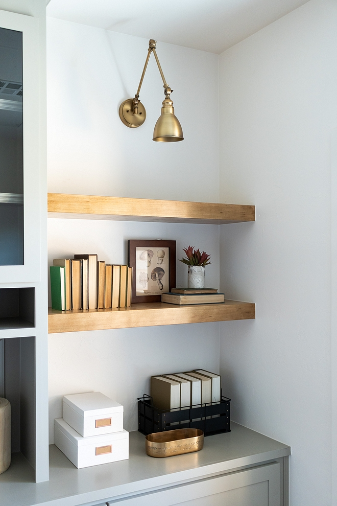 Home Office Floating Shelves Home Office Floating Shelves add an airy feel to this home office Home Office Floating Shelves #HomeOffice #FloatingShelves