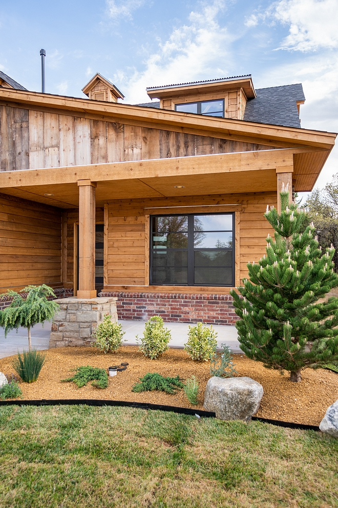 Real reclaimed barnwood accentuates the exterior of this home Rustic Homes Real reclaimed barnwood accentuates the exterior of this home #Realreclaimedbarnwood #exterior #rustichomes