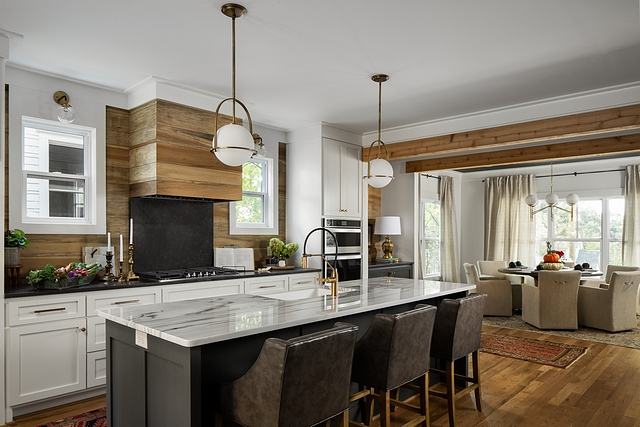 Transitional Rustic Kitchen The kitchen mixes reclaimed wood with white and black cabinetry Transitional Rustic Kitchen The kitchen mixes reclaimed wood with white and black cabinetry #Transitionalkitchen #RusticKitchen #kitchen #reclaimedwood #whitecabinet #blackcabinetry