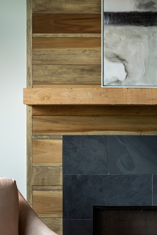Reclaimed shiplap fireplace with reclaimed mantel and Black Slate Surround Mantel is reclaimed beam. The mantle sits out from the top of the fireplace.Hearth Flush: Black Slate Tile #Mantel #reclaimedbeam #fireplace #BlackSlateTile