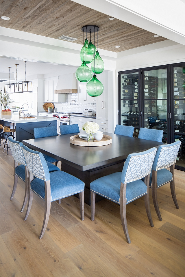 Dining room reclaimed wood shiplap ceiling For this dining room, they chose a reclaimed wood ceiling detail which complimented the wine wall designed by the homeowner Lighting Green blown glass jug cluster lighting #diningroom #reclaimedshiplap #shiplapceiling #ceililingshiplap #shiplap