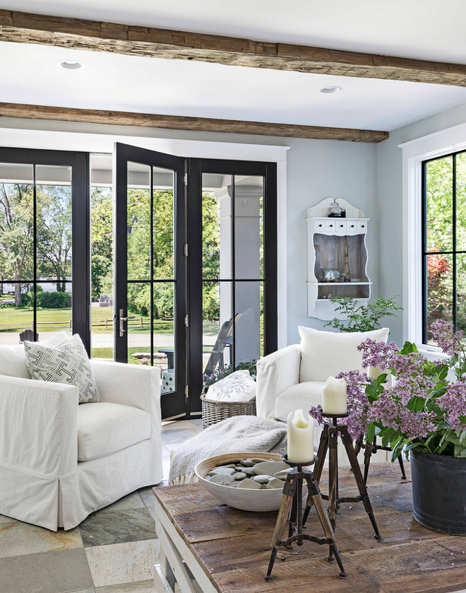 Farmhouse Living Room with Black French Doors Farmhouse Living Room with Black French Doors leading to porch Farmhouse Living Room with Black French Doors #FarmhouseLivingRoom #BlackFrenchDoors