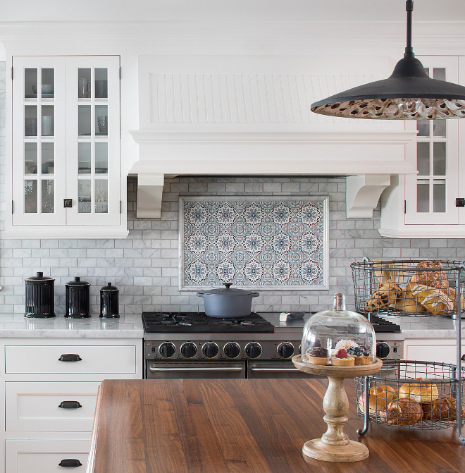 Range Accent Tile Over the range, we added hand painted Carrara tiles with picture moldings Kitchen Range Accent Tile Ideas Range Accent Tile #Range #AccentTile