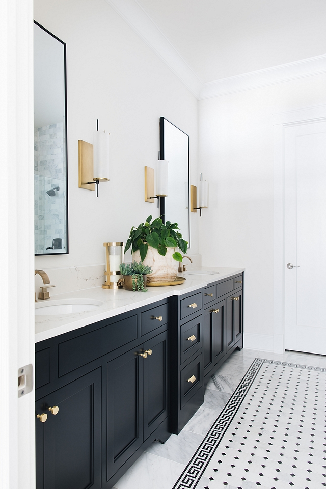 Black and white Bathroom The master bath was inspired by the black and white marble Greek key design Adding a different mosaic tile to the center of the tile rug was bold, but I think it really brought the whole look together Black and white Bathroom Black and white Bathroom Black and white Bathroom #BlackandwhiteBathroom