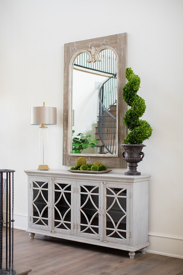 French foyer decor design ideas French home foyer featuring graywash cabinet and reclaimed wood French Mirror and topiary French foyer decor design ideas French home foyer #Frenchfoyer #foyerdecor #foyer #foyerdesign #Frenchhome #entryway #mirror #cabinet #topiary #decor
