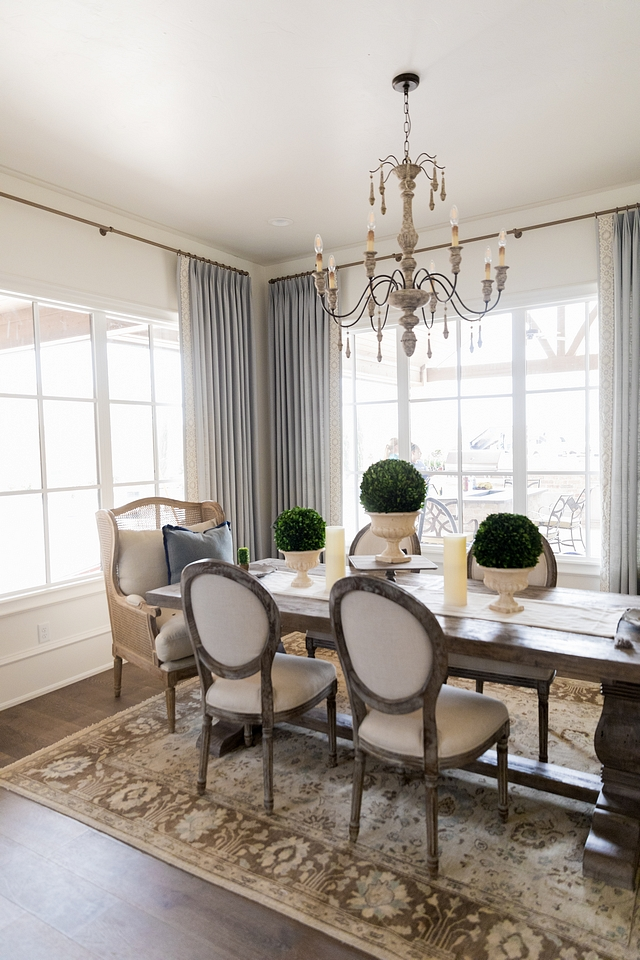 French country dining room The kitchen opens to a stunning dining area with warm decor and custom drapery French country dining room design French country dining room French country dining room French country dining room #Frenchcountrydiningroom #Frenchcountry #diningroom
