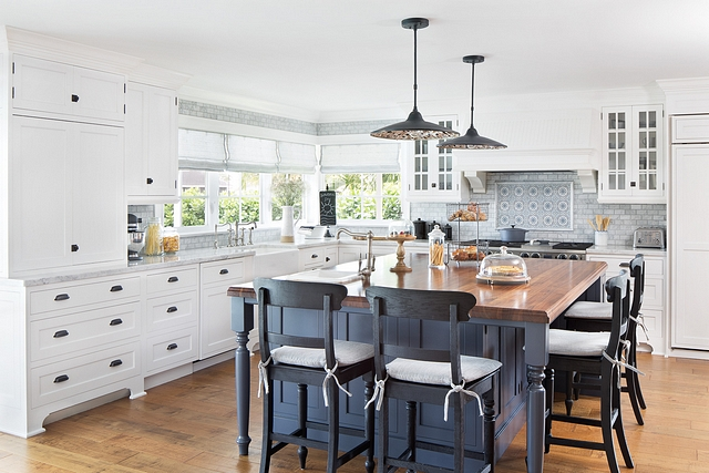 White kitchen with blue steel island In the kitchen, we painted the existing white island a steel blue Cabinets are in Benjamin Moore White Dove #whitekitchen #BenjaminMooreWhiteDove