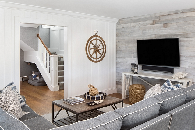 This cozy tv room features a combination reclaimed shiplap and tongue and groove wall paneling #shiplap #tongueandgroove #wallpaneling #paneling