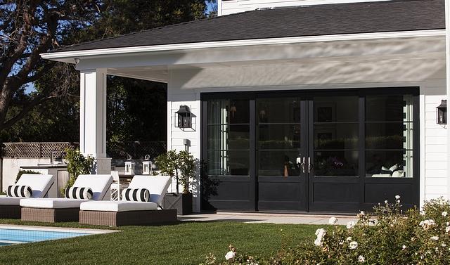 Black Metal Door Black metal patio doors contrast with the white exterior #BlackMetalDoor #Blackmetalpatiodoor