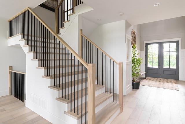 """Wood Staircase Treads Instead of carpet I opted for hardwood stairs with white risers. I shifted away from the thick and heavy spindles and selected thin rails and posts. These white oak posts are only 4"""" wide #staircasetreads #staircase #stairwell #treads"""
