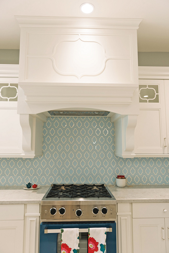 Blue Backsplash Tiles. White Kitchen with blue backsplash tiles and blue range. #Kitchen #BlueBacksplash #BlueTiles #BlueTiling Four Chairs Furniture.