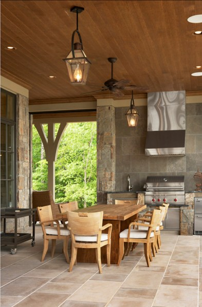 outdoor patio kitchen design idea Lake House with Transitional Interiors - Home Bunch