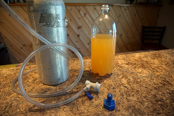 co2 tank connected to a carbonator cap for carbonating cider
