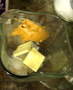 Add white chocolate squares and peanut butter