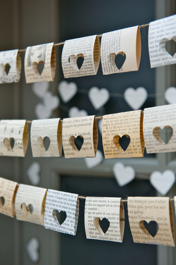 Punch heart shapes through old book pages
