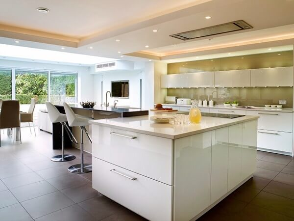 The matt brown tiles soften the contemporary gloss and glass finishes in this modern kitchen.