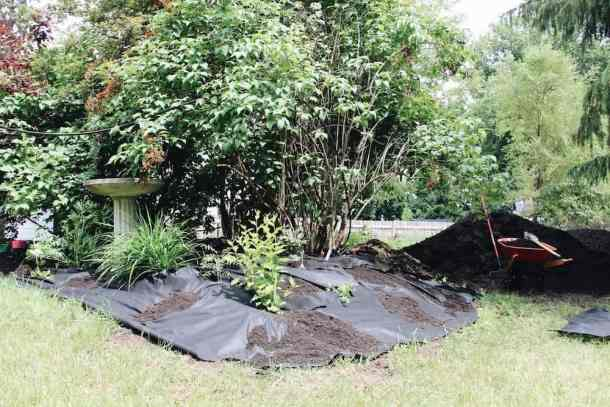 laying landscaping fabric for home garden landscaping