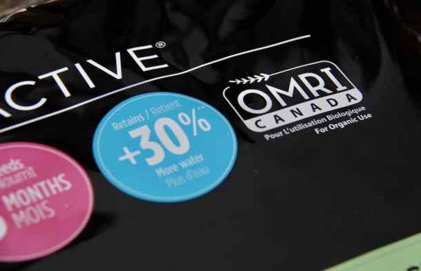 "black plastic herb garden soil bag showing OMRI ""for organic use"" label in white writing"
