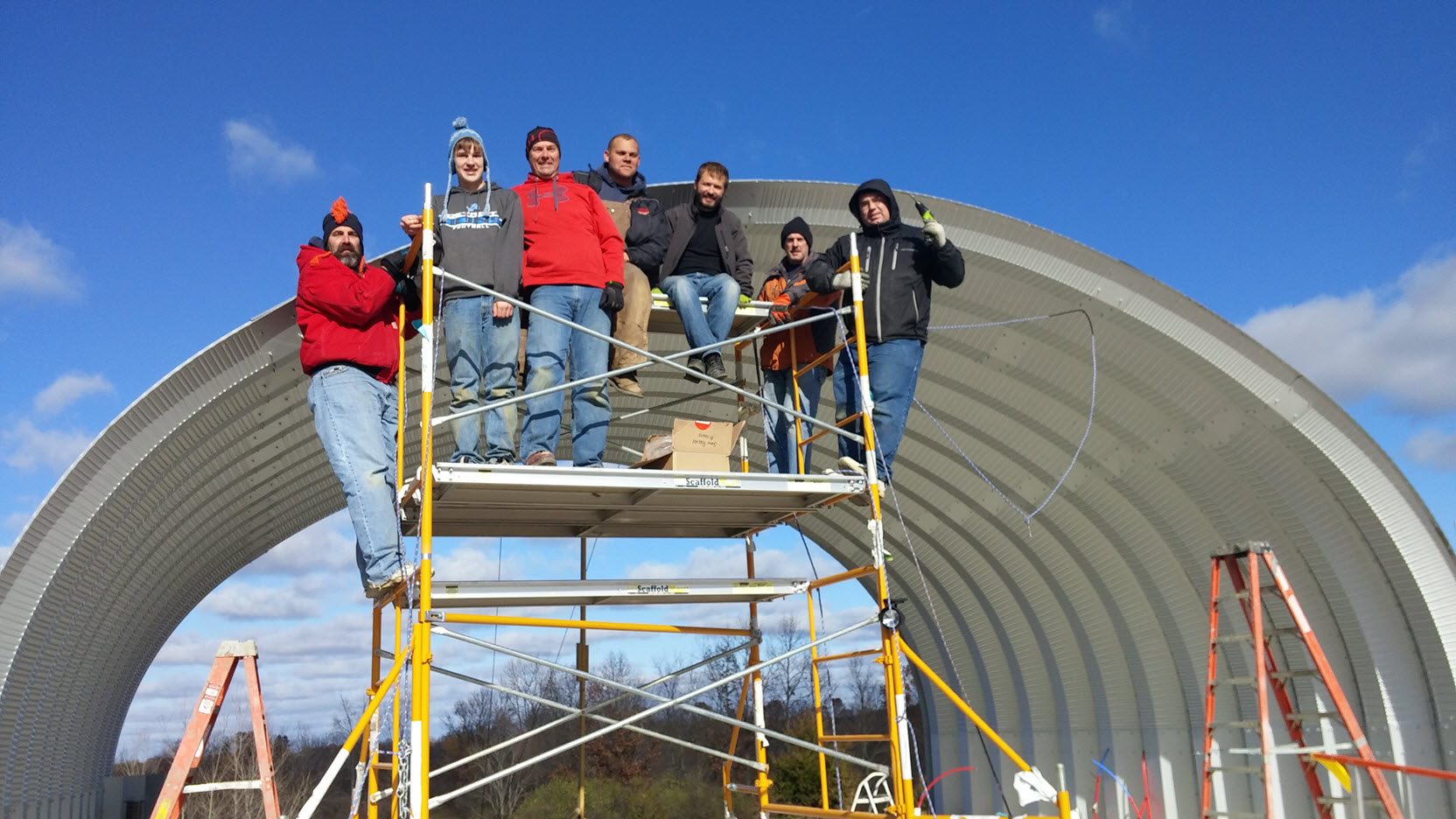 Erecting the quonset hut steel - Home in the Earth