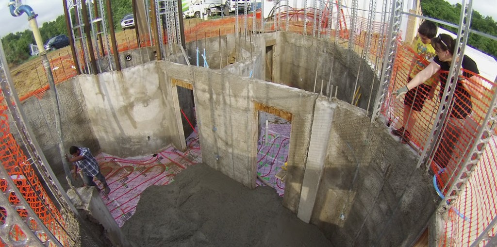 Pouring concrete over the radiant pex pipe