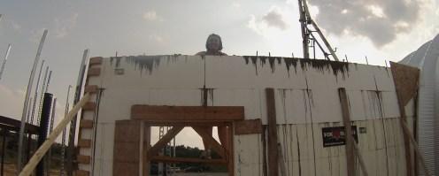Sherri troweling off the wall