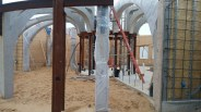 We wrapped the concrete arches to protect them from the shotcrete overspray.
