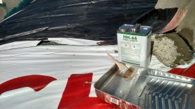 We glued the vinyls together with HH-66 vinyl cement. It basically melts them together with a chemical bond.