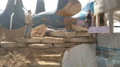 Lifting the first vertical stone...