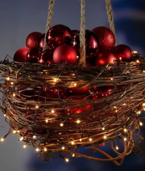 time for a little bit modern style light ideas with ornamental baskets this delightful wire basket is wrapped with grape vine and christmas lights