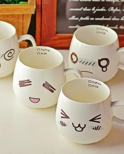 smart idea porcelain coffee mugs. Funny facial expressions will make your mugs come to life  You can use sharpie pens for this cute idea HomelySmart 13 DIY Coffee Mug Inspiration