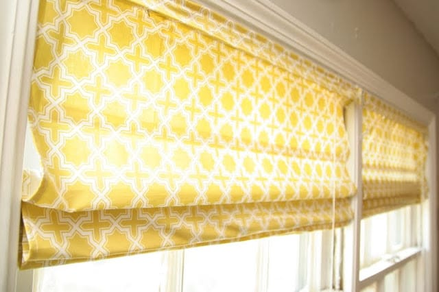 Learn how to make roman shades with mini blinds in just a few easy steps. These roman shades are inepensive to make and can be totally customizable!
