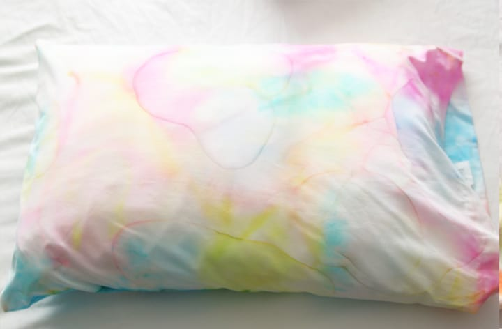 Create an easy pillowcase craft for kids using Sharpies and rubbing alcohol. You will get a beautiful watercolor effect that looks custom made!