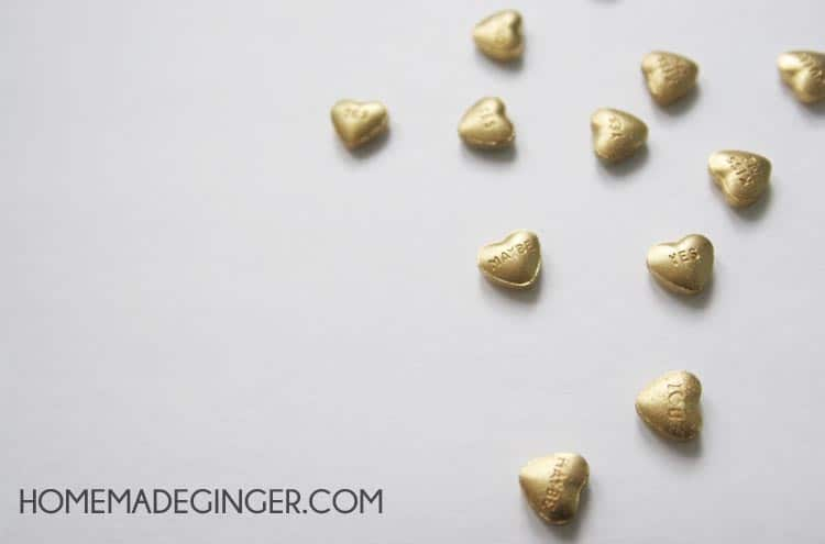 Spray paint some conversation hearts gold and turn them into earrings! Such a fun and easy Valentines day craft!