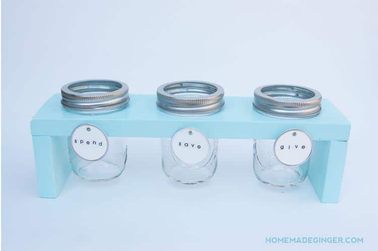 This DIY piggy bank is easy to make even if you don't have much DIY experience. We will show you how to create a wooden stand for 3 mason jars.