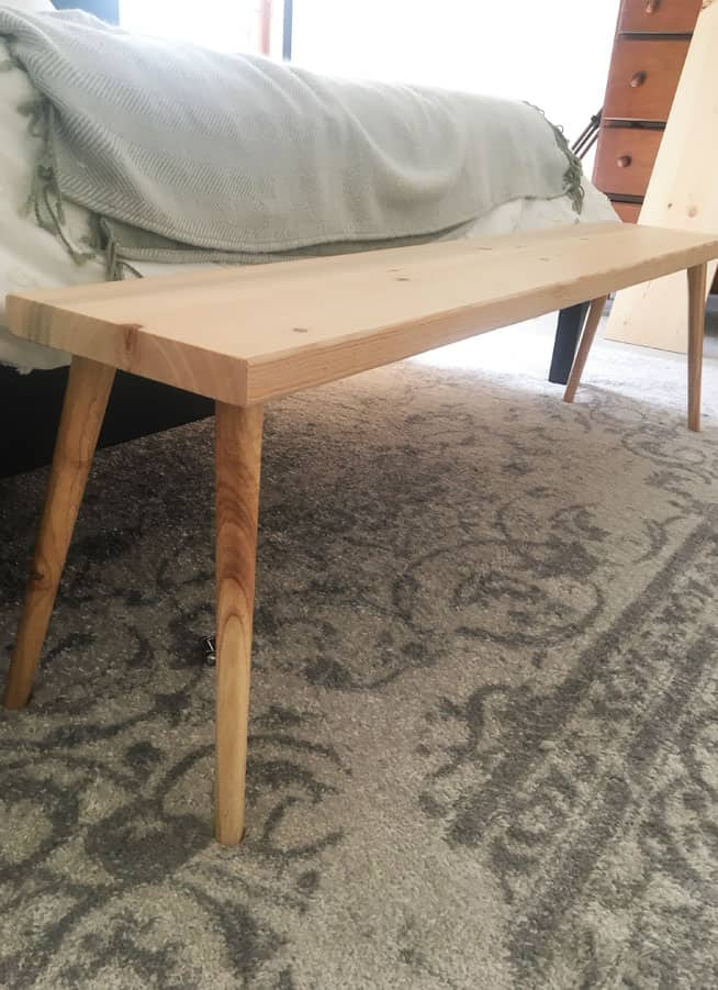 Make a DIY Modern bench in 30 minutes with just a few supplies. This is an inexpensive DIY mid century modern furniture tutorial!