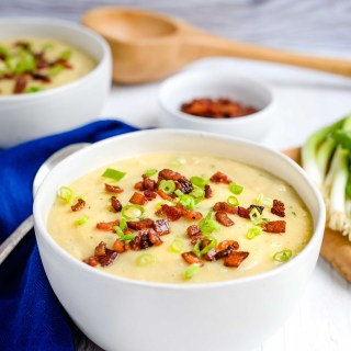 This lightened up Potato, Cauliflower and Leek Soup includes an entire head of nutrient and fiber-rich cauliflower swapped in for half of the potatoes. A hint of bacon and a pureed texture provide indulgent richness without cream.