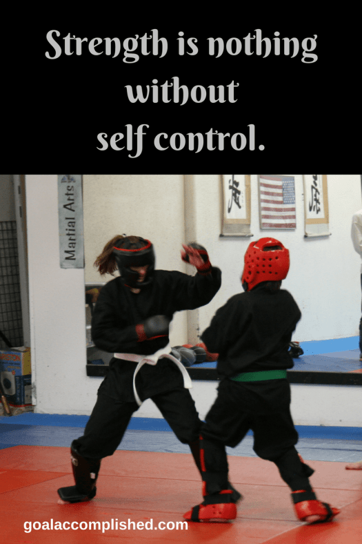 Mom gets her child martial arts lessons. Two martial arts students are sparring.