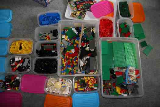 LEGOS separated into multiple size boxes by color