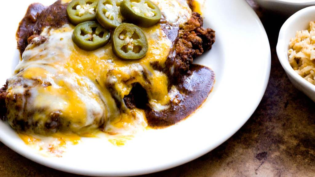 Chicken fried steak with red chile gravy and cheese | Homesick Texan